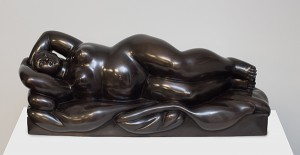 Reclining Woman on a Bed bronze sculpture with brown patina by artist Fernando Botero