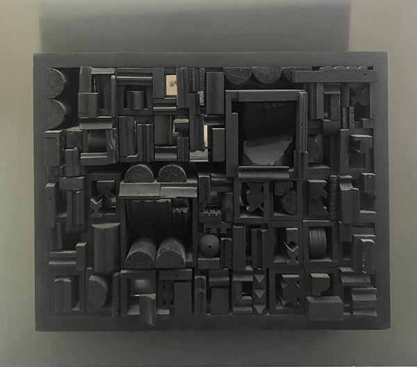 """City Scape"" black painted wood with plexi back sculpture by artist Louise Nevelson"